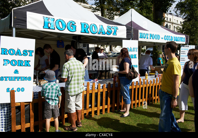 Hog roast and pork stuffing stall at a food festival Leamington Spa Warwickshire - Stock Image