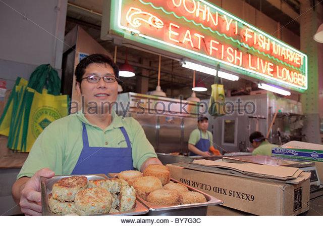 Philadelphia Pennsylvania Reading Terminal Market Center City historic farmers market local food merchant stall - Stock Image