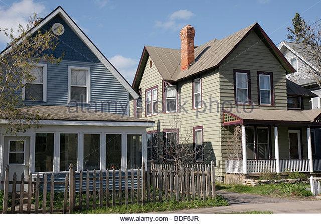 Michigan Upper Peninsula U.P. UP Lake Superior Marquette Ridge Street house wood fence exterior neighborhood single - Stock Image