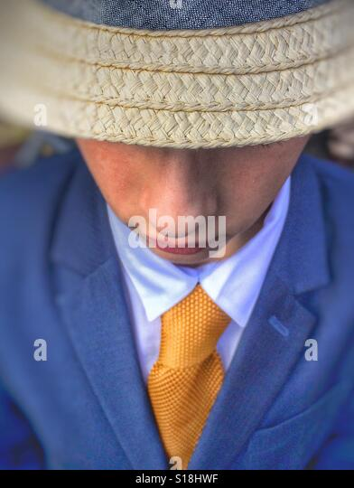 A young boy wearing a hat, suit & tie - Stock Image