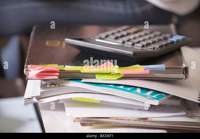 textbooks and calculator on desk - Stock Image