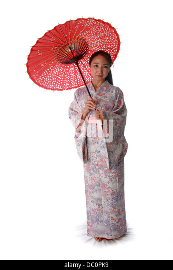 Japanese Lady Wearing a Pink and Lilac Patterned Kimono and Holding a Red Sun Shade. - Stock Image