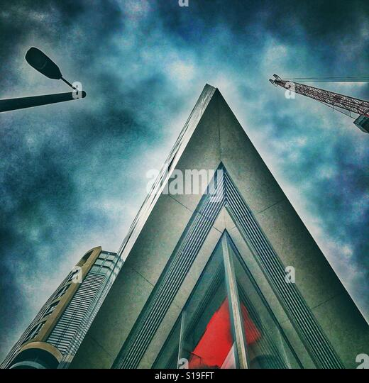Looking up at a pointed building - Stock Image