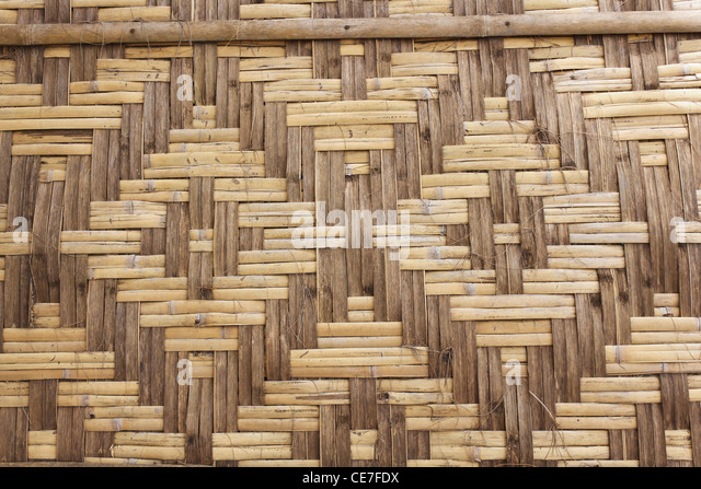 Old bamboo weave wall of hut in Thailand - Stock-Bilder