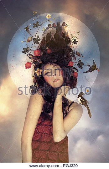 young dreaming woman with flowers in her hair - Stock Image