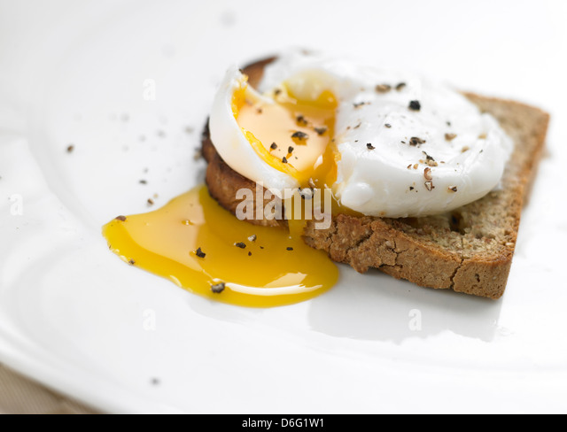 Poached Egg on toast - Stock Image