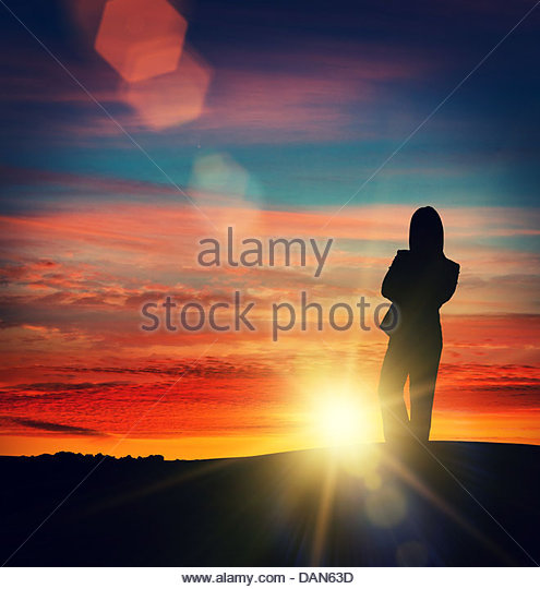 silhouette sun woman - Stock Image