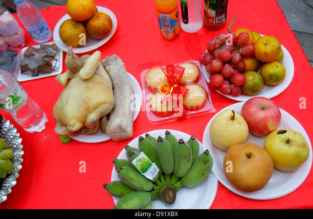 Bangkok Thailand Pathum Wan Phaya Thai Road MBK Center centre complex Chinese New Year event religious offerings - Stock Image
