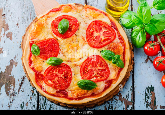 pizza with mozzarella and tomatoes - Stock Image