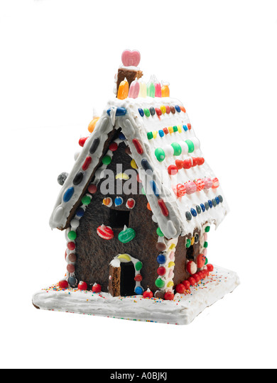 Traditional ginger bread house covered in sweets and icing stock