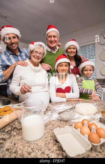 Multi-generation family baking together - Stock Image