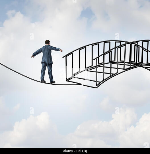 Risk reduction concept as a businessman on a tightrope walking on a wire that becomes shaped as a safe three dimensional - Stock Image