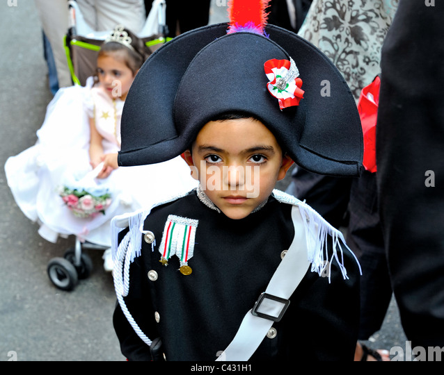 A young Italian boy at a Little Italy feast in a Carabinieri uniform. Stock Photo