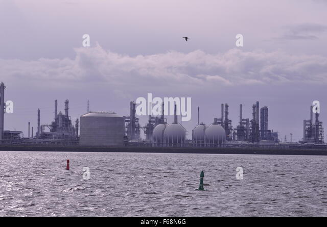 industry Teesport Tees Mouth industry fossil fuels fuel tank tanks reflection River river Cleveland UK - Stock Image