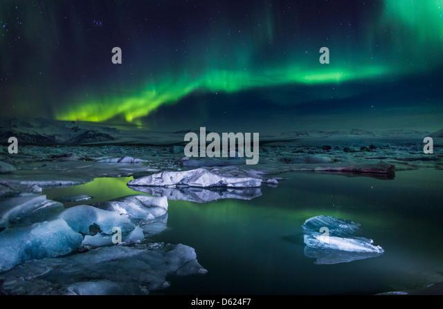 Aurora Borealis or Northern lights at the Jokulsarlon, Breidarmerkurjokull Vatnajokull Ice Cap, Iceland - Stock Image