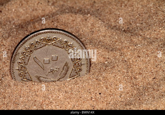 I have an Iranian coin. SIlver withe eagle and shield one side.?