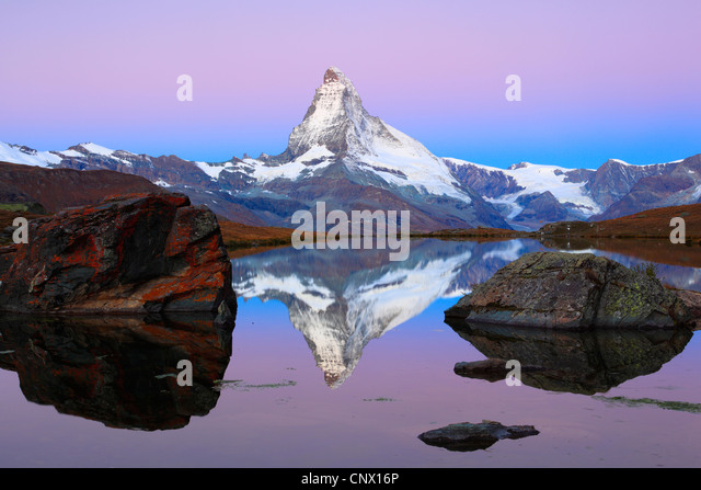 view at the Matterhorn from a mountain lake, Switzerland, Valais - Stock Image