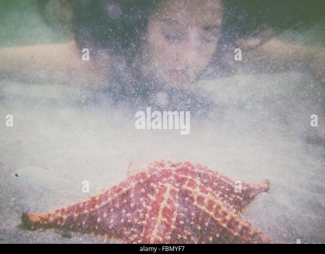 Young Woman Swimming In Sea - Stock Image