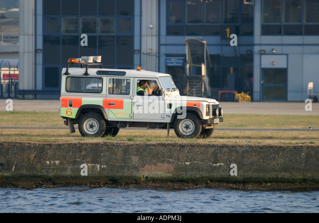 Airport worker in Land Rover. London City Airport, England, UK - Stock Image