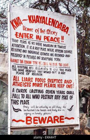 Johannesburg South Africa African Soweto Kwa-Khaya Lendaba Credo Mutwa Cultural Village sign entrance warning curse - Stock Image