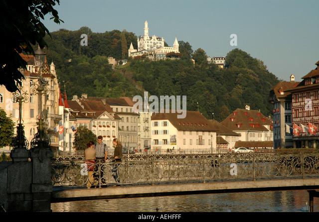 Lucerne luzern Switzerland Reuss River architecture green hillside summer - Stock Image