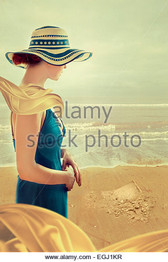young woman standing on beach - Stock Image
