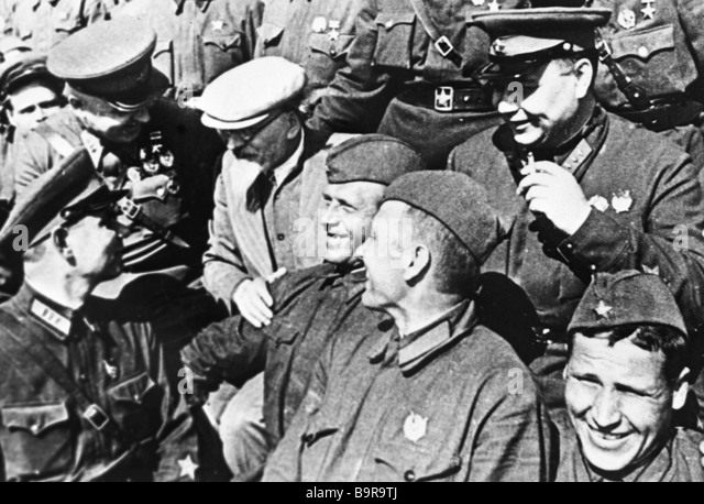 Mikhail Kalinin talks to Red Army commanders and soldiers in Vyborg city - Stock Image