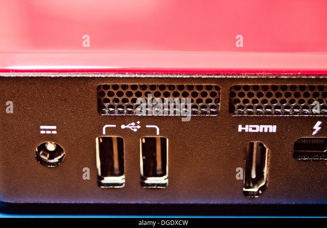 Close-up photograph of the rear connections on a modern mini desktop computer - Stock Image
