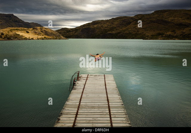 Torres del Paine National Park Chile. man diving lake Torres del Paine Chile - Stock Image