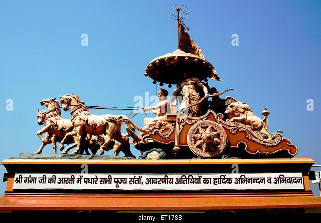 Statue shree krishna arjuna in chariot at swarg ashram ; Rishikesh ; Uttaranchal Uttarakhand ; India 2010 - Stock Image