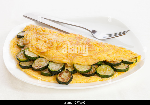 Omelet with zucchini or courgette, whole object. - Stock Image