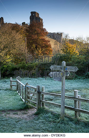 Corfe Castle sunrise in Dorset on a foggy cold Autumn morning. - Stock Image
