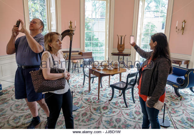 South Carolina Charleston SC Historic Downtown Nathaniel Russell House Museum historic home music room woman man - Stock Image