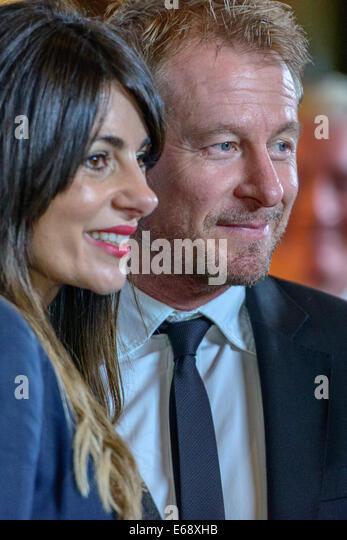 Sydney, Australia. 18th Aug, 2014. Richard Roxburgh and Silvia Colloca arrive at the 2014 Helpmann Awards at the - Stock Image