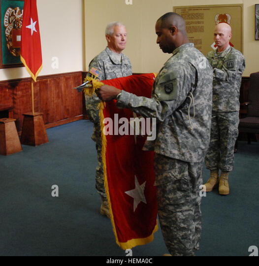 Maj. Gen. Lawrence Wayne Brock III is presented with the general officer's flag by Command Sgt. Maj. Damien - Stock Image