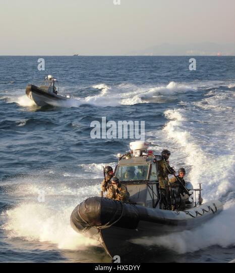 Republic of Korea (ROK) Special Warfare Flotilla and SEAL Team 17 prepare for a visit, board, search and seizure - Stock Image