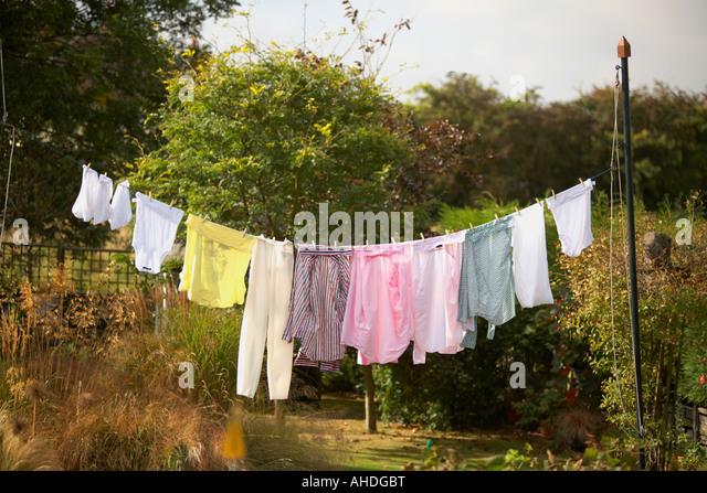 washing hanging on line outside in garden - Stock-Bilder