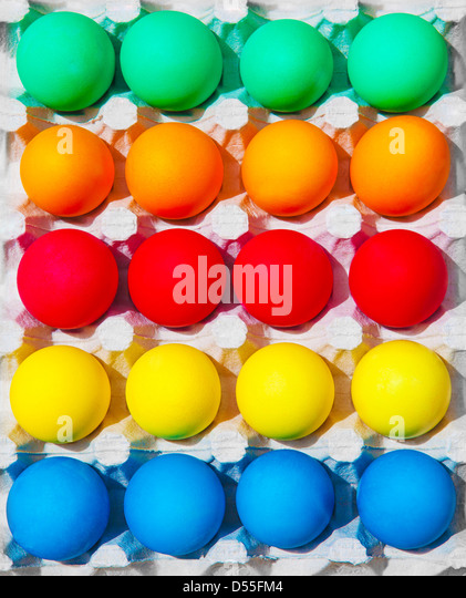 Variety of colorful Easter eggs in box, festive abstract background, traditional food for spring holiday - Stock Image