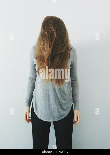 Woman Covering Her Face With Her Hair - Stock Image