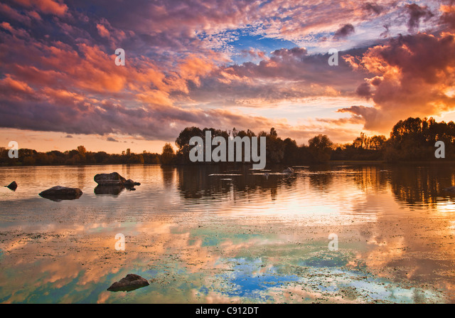 An autumn sunset over the lake at Colwick Country Park, Nottingham, Nottinghamshire, England, UK - Stock Image