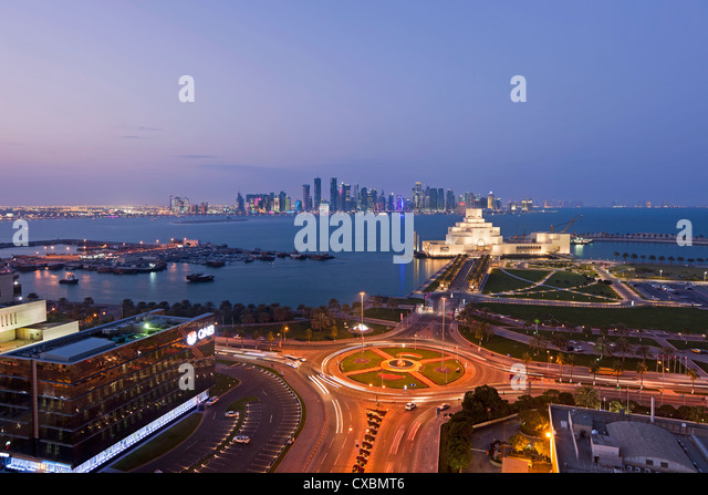 Elevated view over the Museum of Islamic Art and the Dhow harbour to the modern skyscraper skyline, Doha, Qatar, - Stock Image