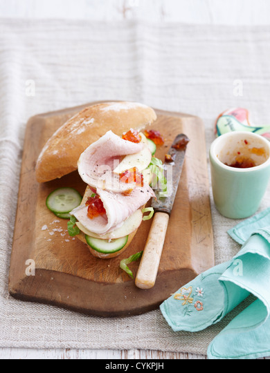 Sandwich with relish ham and cucumber - Stock Image