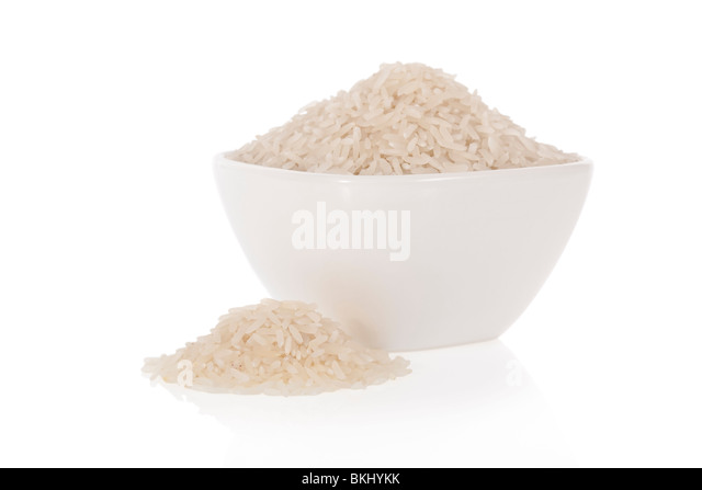 Long grain white rice in a bowl isolated on a white background - Stock Image