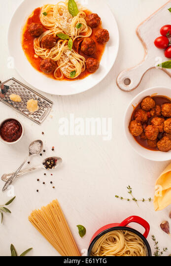 Spaghetti with meatballs with fresh basil and tomato sauce - Stock Image
