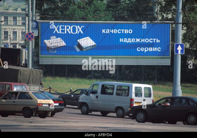 Russia former Soviet Union Moscow Xerox billboard ad city traffic multinational company - Stock Image