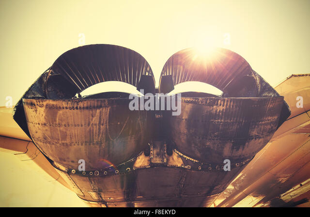 Retro toned jet exhaust pipes against sun. - Stock Image