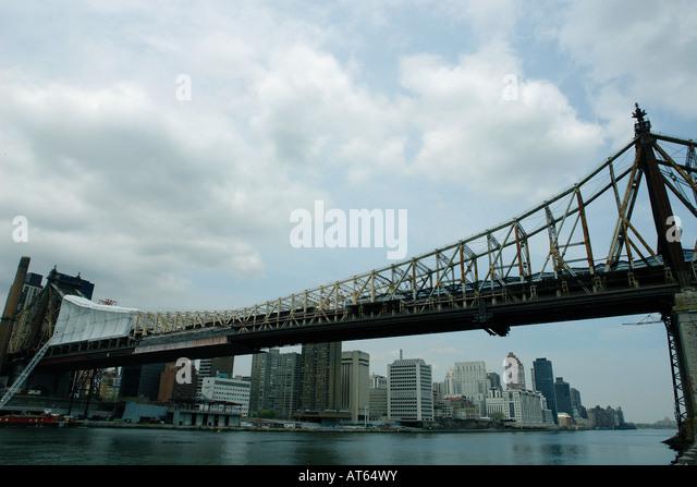 Upper East Side of Manhattan and Queensboro Queensborough Bridge in Queens New York City USA - Stock Image