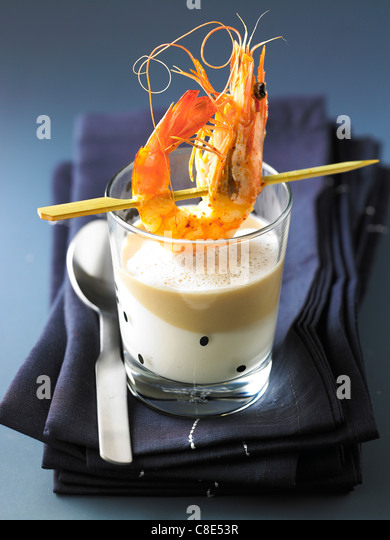 Cream of parsnip,chestnut emulsion and grilled gambas - Stock Image