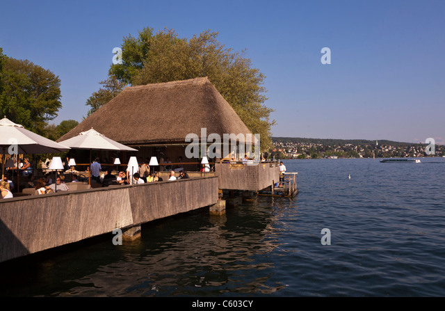 Fischerhuette at Zurich lake, Switzerland Zuerich, lake promenade , people , - Stock Image