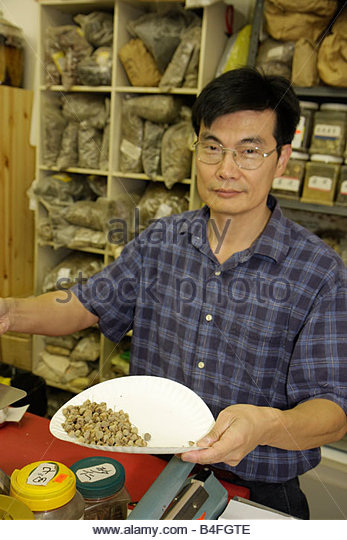 Orlando Florida Colonial Drive Little Vietnam Health Food City Asian man store shop alternative medicine ethnic - Stock Image